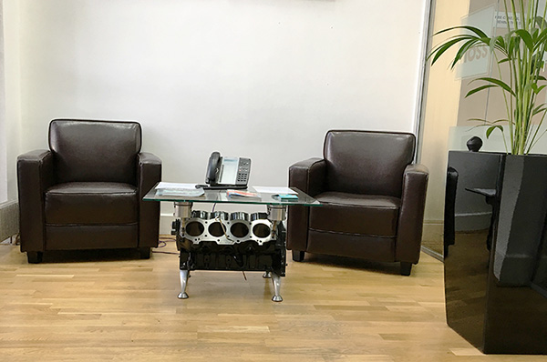 Furniture made from car parts this hodge podge of for Engine parts furniture